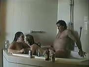Hot youthfull wives enjoy threesome sex with an older man in the bath